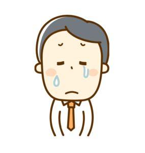 悲しい顔のビジネスマン